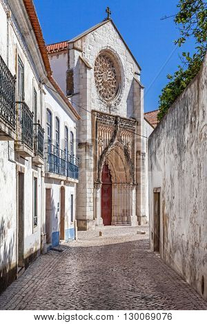 Santo Agostinho da Graca church, seen from one of the old streets of Santarem. 14th and 15th century Mendicant and Flamboyant Gothic Architecture. Santarem, Portugal.