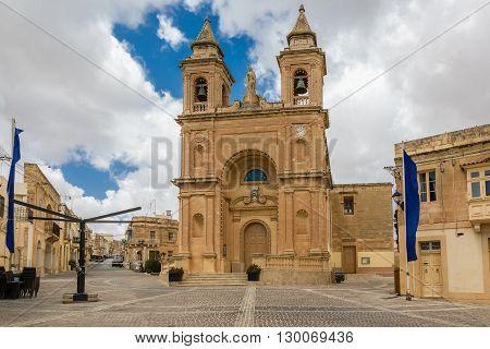 Marsaxlokk Parish Church on Malta island. A place of pilgrimage in the fishing village. poster