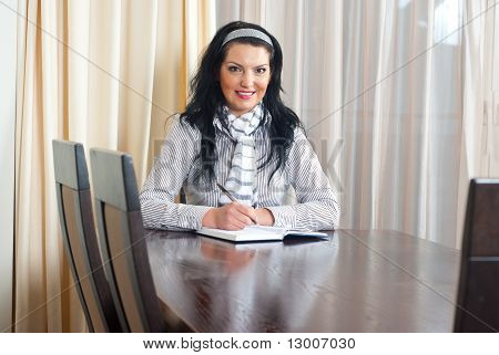 Happy Woman Writing At Table