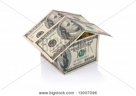 House Built With Dollar Money Bills Isolated With Clipping Path
