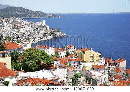The city on the seashore. Houses with tile roofs. Photo