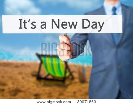 It's A New Day - Businessman Hand Holding Sign
