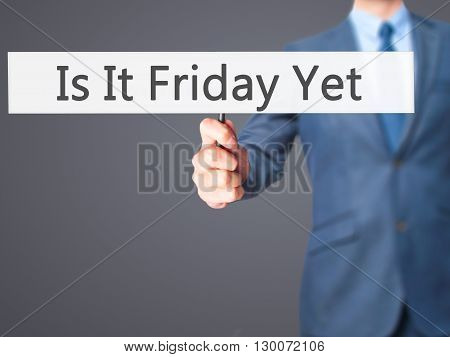 Is It Friday Yet - Businessman Hand Holding Sign