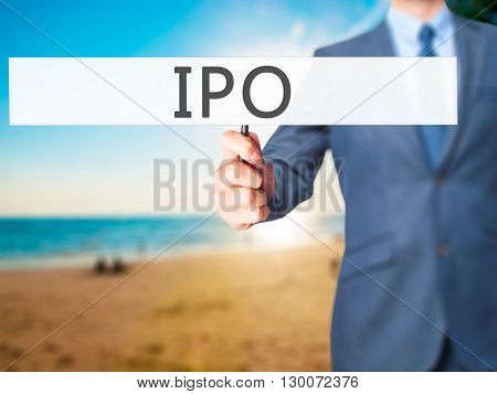 Ipo - Businessman Hand Holding Sign