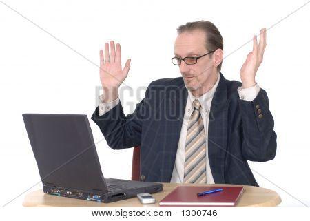 Surprised Looking Businessman Working On Laptop