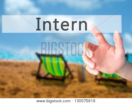 Intern  - Hand Pressing A Button On Blurred Background Concept On Visual Screen.