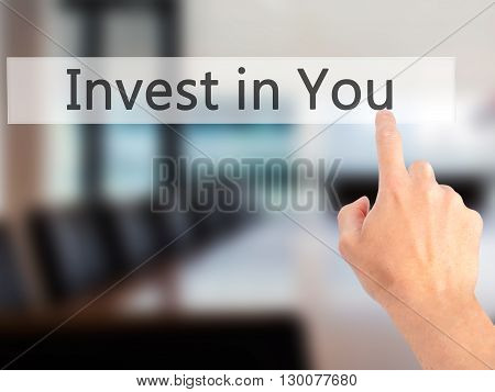 Invest In You - Hand Pressing A Button On Blurred Background Concept On Visual Screen.