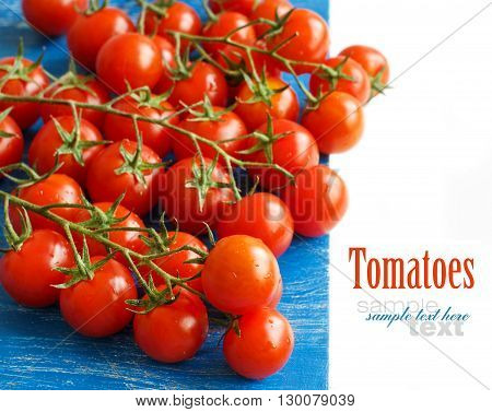 Cherry tomatoes on the old blue wooden background