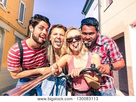 Multiracial best friends selfie photo and fun on summer vacation - Multiethnic happy group self photo with tongue out in old town tour - Teenagers students joyful moments using mobile phone technology