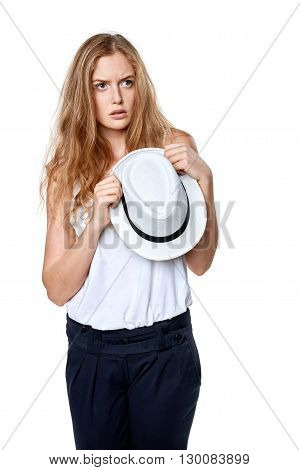 Displeased sullen woman holding straw hat looking away at blank copy space