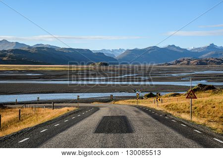The Ring Road pass through mountain and river landscape in summer of Iceland
