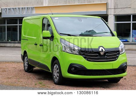 RAASEPORI FINLAND - MAY 15 2016: Lime green Renault Trafic DCi 140 parked on a yard.