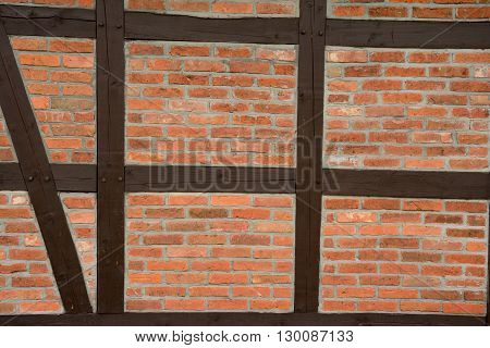 Prussian wall texture. Red bricks and brown wooden beams.