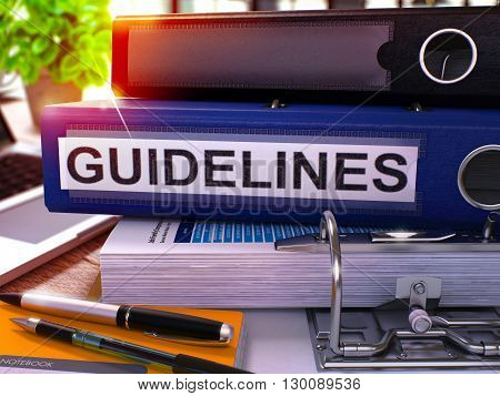 Blue Ring Binder with Inscription Guidelines on Background of Working Table with Office Supplies and Laptop. Guidelines Business Concept on Blurred Background. 3D Render.