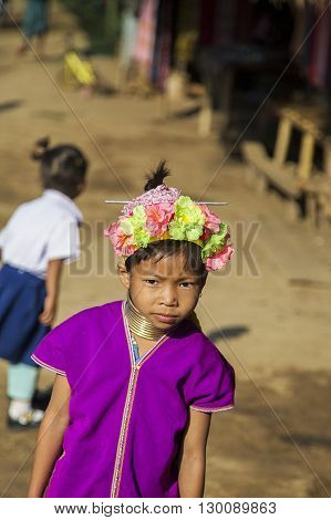 CHIANG MAI, THAILAND - FEBRUARY 2, 2016: Unidentified girl from Karen Long Neck Village near Chiang Mai Thailand. This village is a part of very popular Hill tribe tourism in Thailand.
