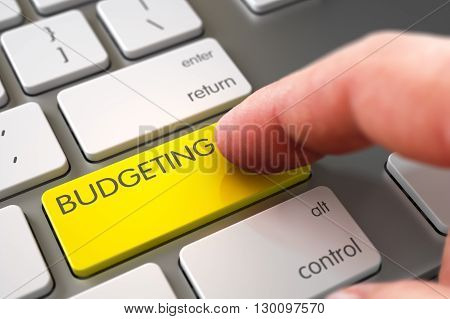 Hand Pushing Budgeting Yellow Computer Keyboard Key. Budgeting Concept - Computer Keyboard with Budgeting Keypad. Close Up view of Male Hand Touching Budgeting Computer Key. 3D.