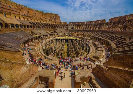 ROME, ITALY - JUNE 13, 2015: Roman Coliseum inside view, historical monument and turists walking around.