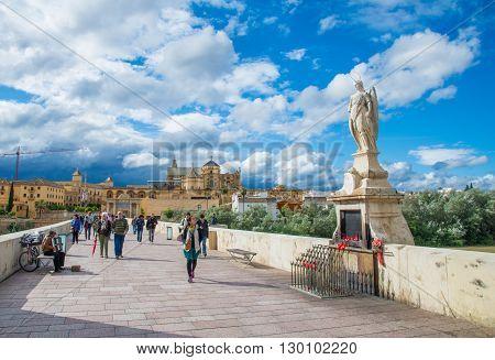 Cordoba, Spain - May 10, 2016: San Rafael statue of the Roman bridge in Cordoba, Spain