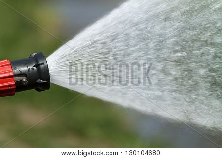 jet of water under high pressure, beating of a fire hose