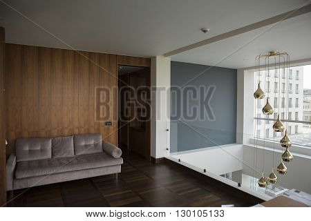 sofa and chandalier in a luxury duplex apartment