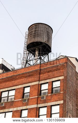Water tank on top of a red brick brownstone building in New York City