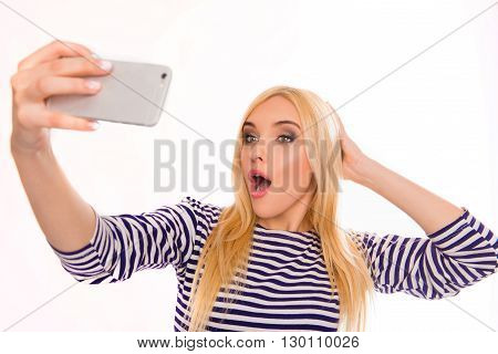 Creative Blonde Making Funny Selfie With Open Mouth