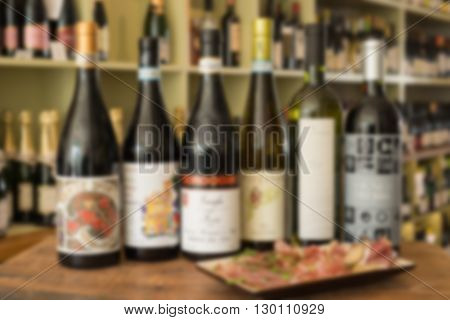 Blurred Shot of Bottles of Wine and Plate of Deli Meat