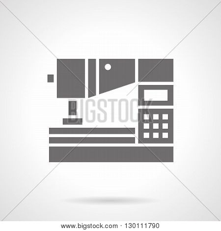 Computerized equipment for workshop. Sewing machine with digital control panel. Factory production with modern manufacture. Symbolic black glyph style vector icon.