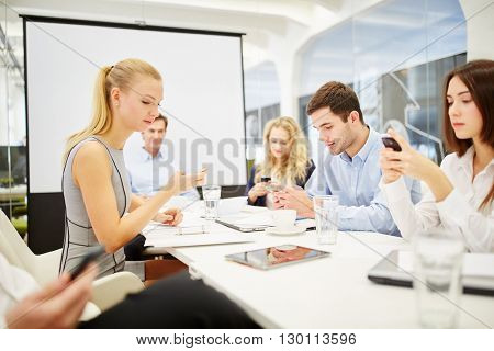 Businessteam of business people communicates with their smartphones