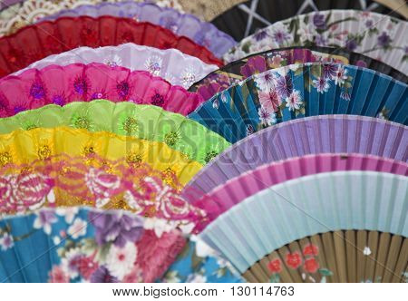Colorful Chinese fan with traditional details, close up of folding fan