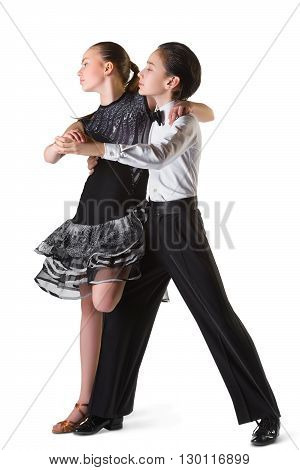 Boy and girl or beautiful couple in the active ballroom dance on white background.