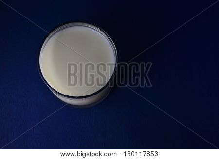 Top view of a glass full of milk, which looks like a 'moon'. It has a special significance at the end of Ramadan.