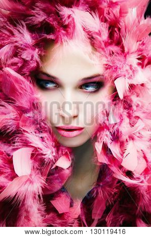 beautiful young woman beauty portrait with pink feathers studio shot composite photo