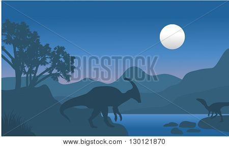 eoraptor and parasaurolophus in river scenery silhouette at tthe night