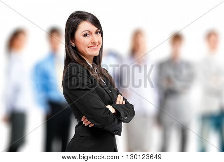 Business woman in front of her team