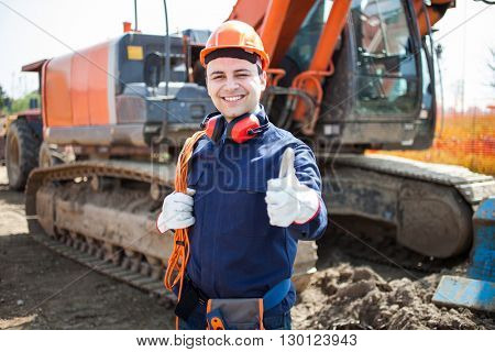 Portrait of an happy worker in a construction site