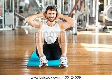 Man working out his abs in a gym