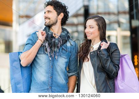 Couple doing shopping in a urban street