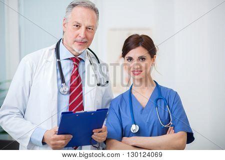 Senior doctor and nurse portrait