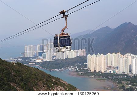 The cabin of a ropeway over the city, sea and mountains. Beautiful landscape.