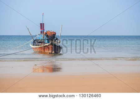 Beautiful beach against seaview with fishing boats dock at kata beach, Phuket, Thailand