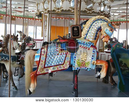 BROOKLYN, NY - MAY 14, 2016: Historic Marcus Illions Horse on the B&B Carousel. The horse was carved in 1909, the same year the Lincoln penny was issued, in honor of the Centennial of Lincoln's birth