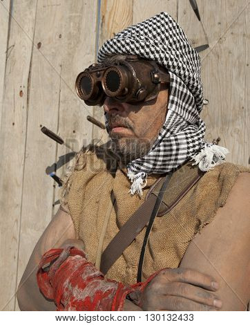 Steampunk man wearing glasses. Post-apocalypse fantasy