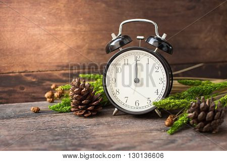 Vintage alarm clock on old wood wall table for decoration.
