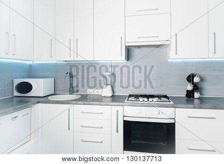 modern white kitchen in minimalism style, frontal view