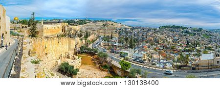 JERUSALEM ISRAEL - FEBRUARY 18 2016: The panoramic view on the hilly streets of the city its ramparts Mosques on the Temple Mount cemetery on the Olive Mount on February 18 in Jerusalem.