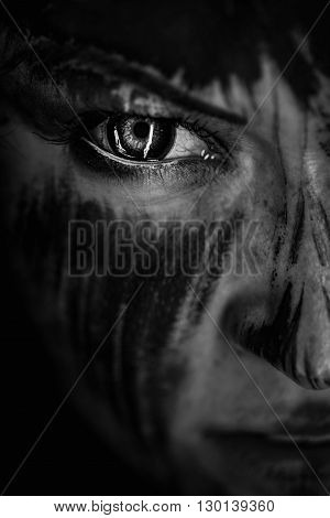 Cloce-up scary portrait of angy woman. Demon theme on Halloween. Black-and-white Version of the Image