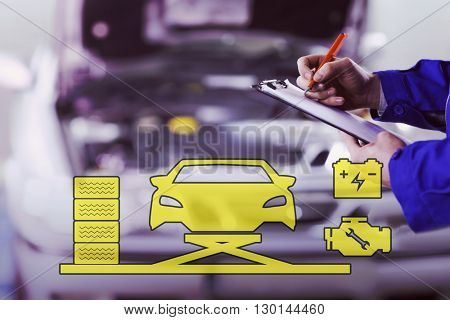 Mechanic graphic against close up of a man writing on a clipboard