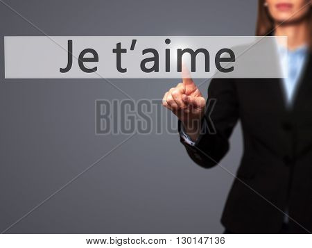 Je T'aime ( I Love You In French) - Businesswoman Hand Pressing Button On Touch Screen Interface.