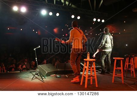 PATCHOGUE, NY-FEB 3: Musicians Stephen Barker Liles (R) and Eric Gunderson of Love and Theft perform onstage at The Emporium on February 3, 2016 in Patchogue, New York.